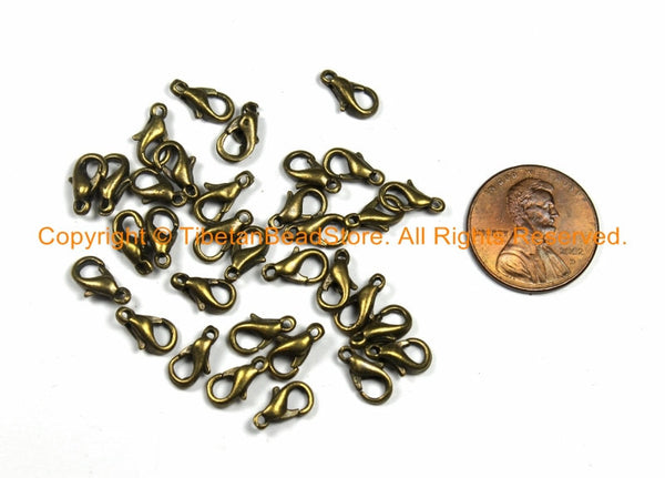 10 PIECES Small Antique Brass Lobster Clasps 10mm Long - TibetanBeadStore Supplies, Beads, Pendants - F96-10 - TibetanBeadStore