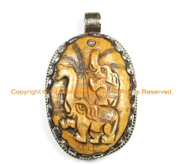 OOAK Tibetan Ethnic Tribal Old Bone Hand Carved Double Elephants Pendant with Repousse Lotus Floral Details - TibetanBeadStore - WM6449