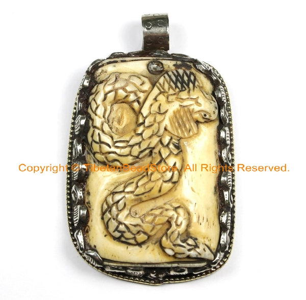 OOAK Tibetan Ethnic Tribal Old Bone Hand Carved Snake Serpent Pendant with Repousse Lotus Floral Details - TibetanBeadStore - WM6426