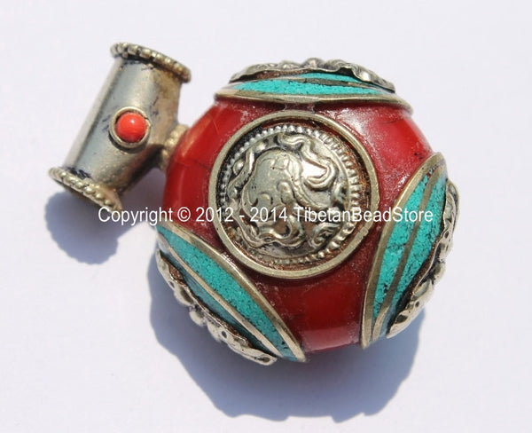 Tibetan Reversible Round Red Copal Resin Pendant with Turquoise Inlays, Tibetan Silver Repousse Auspicious Conch & Vajra Details - WM4110