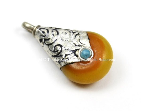 Small Ethnic Tibetan Yellow Honey Amber Resin Drop Amulet Charm Pendant with Repousse Tibetan Silver Caps, Blue Bead Accent - WM5680A-1