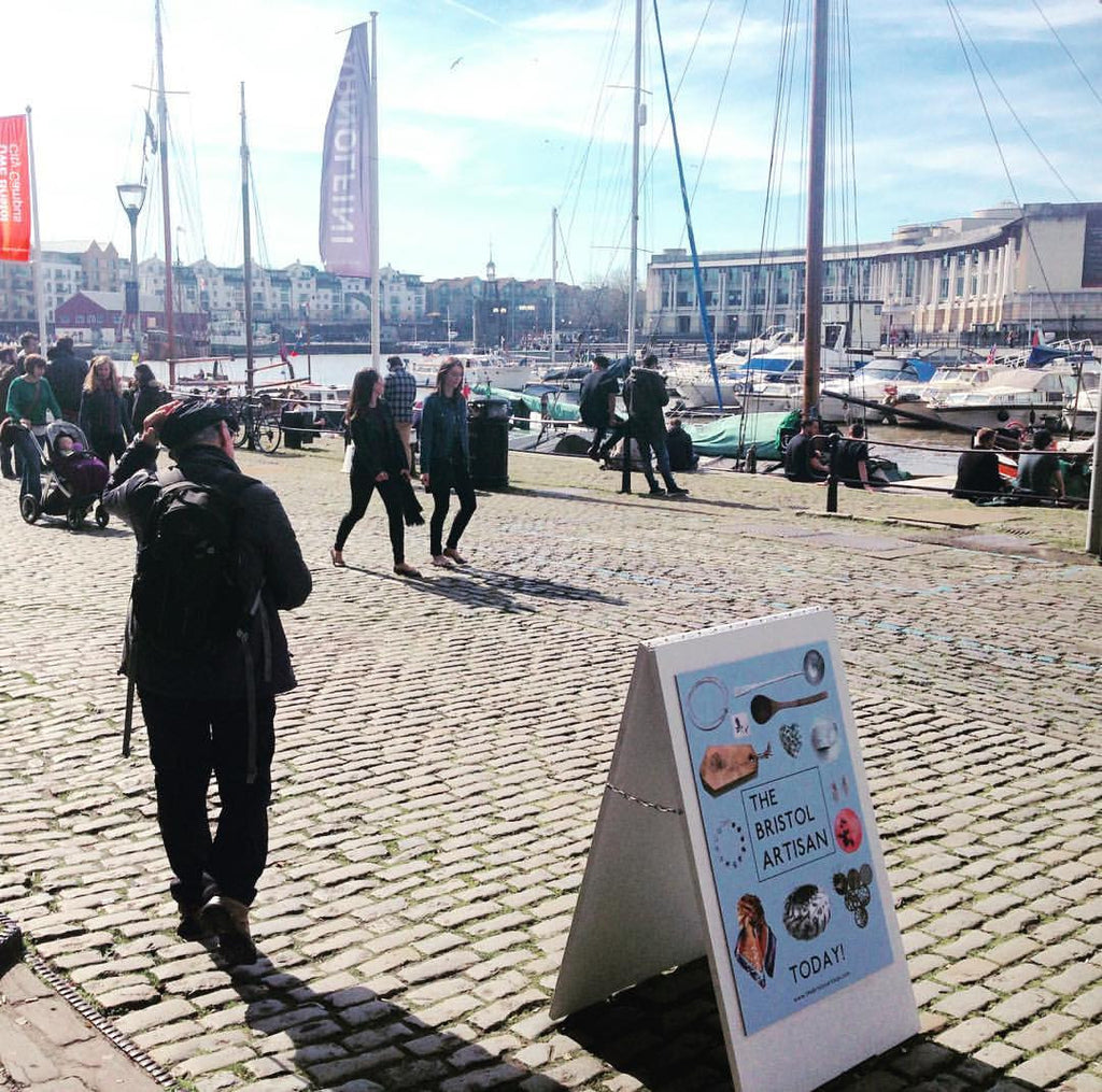 Outside the Arnolfini stands a Bristol Artisan sign