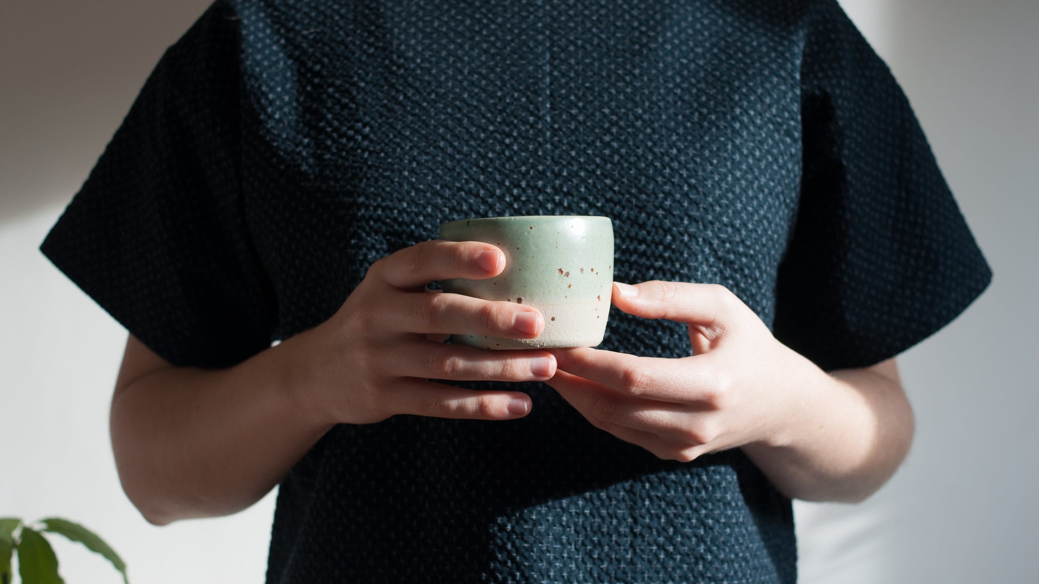 Viola holding a Celadon and Speckle Tea Bowl Dor and Tan
