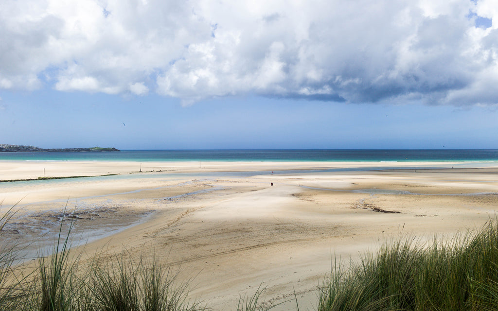 Shadows across Hayle beach, St Ives can be seen in the background