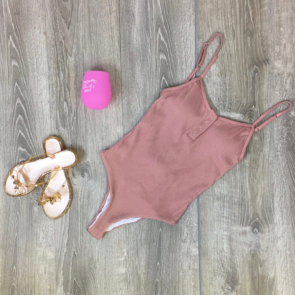 blush one piece bathing suit