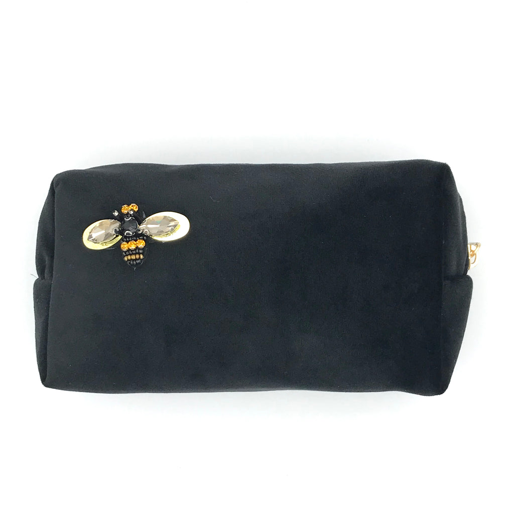 Velvet make-up bag in black with a bumblebee pin