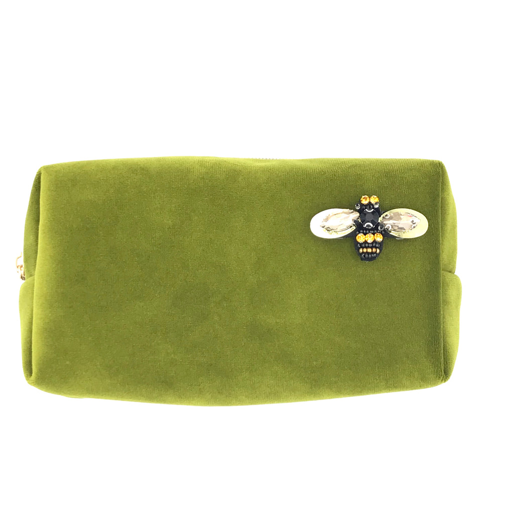 Velvet make-up bag in chartreuse with a bumblebee pin