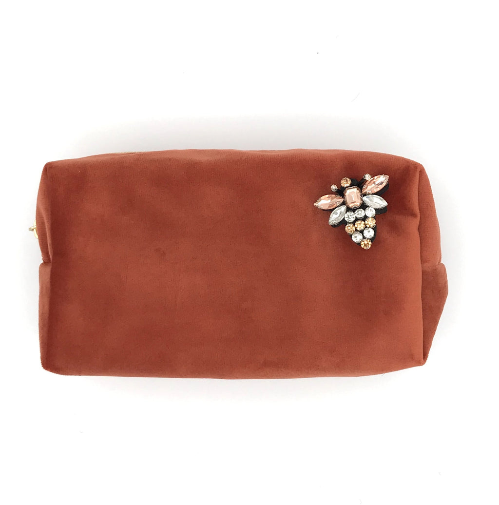 Velvet make-up bag in coral with a queen bee pin, large