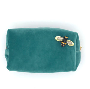 Velvet make-up bag in duck egg with a queen bee pin