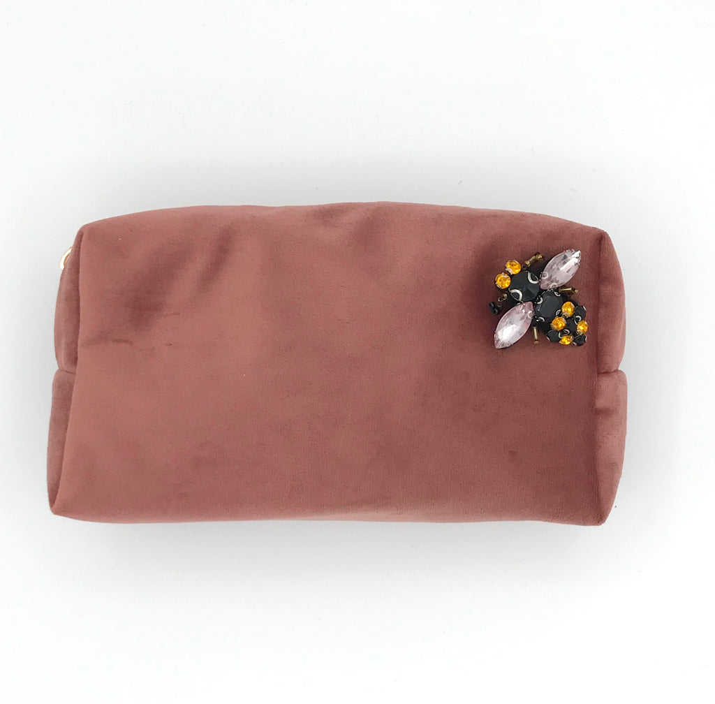 Velvet make-up bag in dusky pin with a bumblebee pin