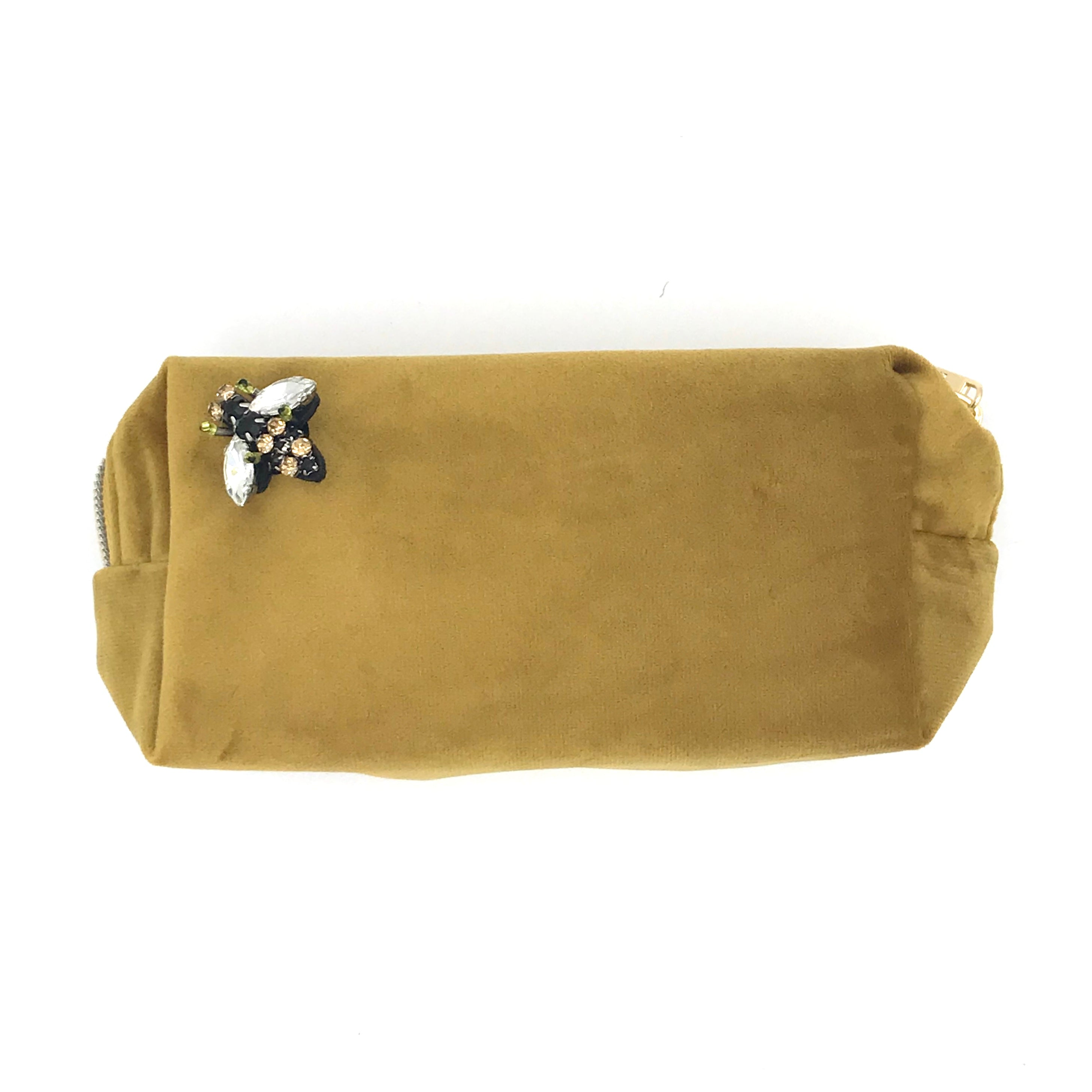 Velvet make-up bag in gold with a queen bee pin