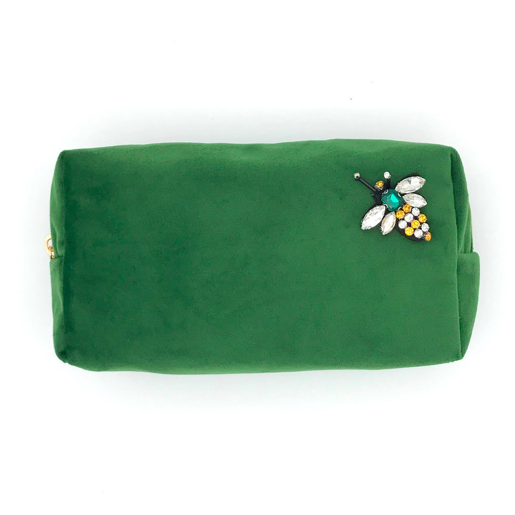 Velvet make-up bag in green with a queen bee pin