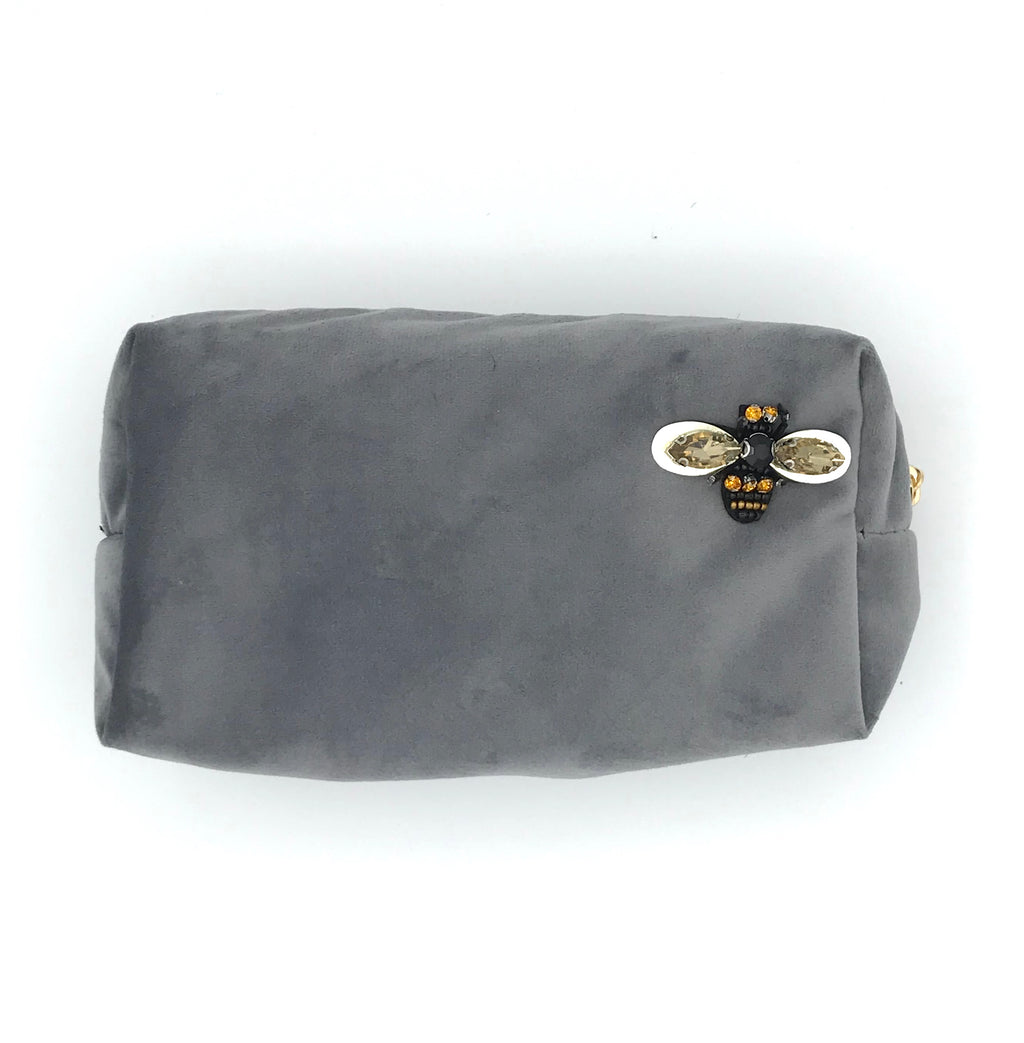 Velvet make-up bag in grey with a sparkly insect pin