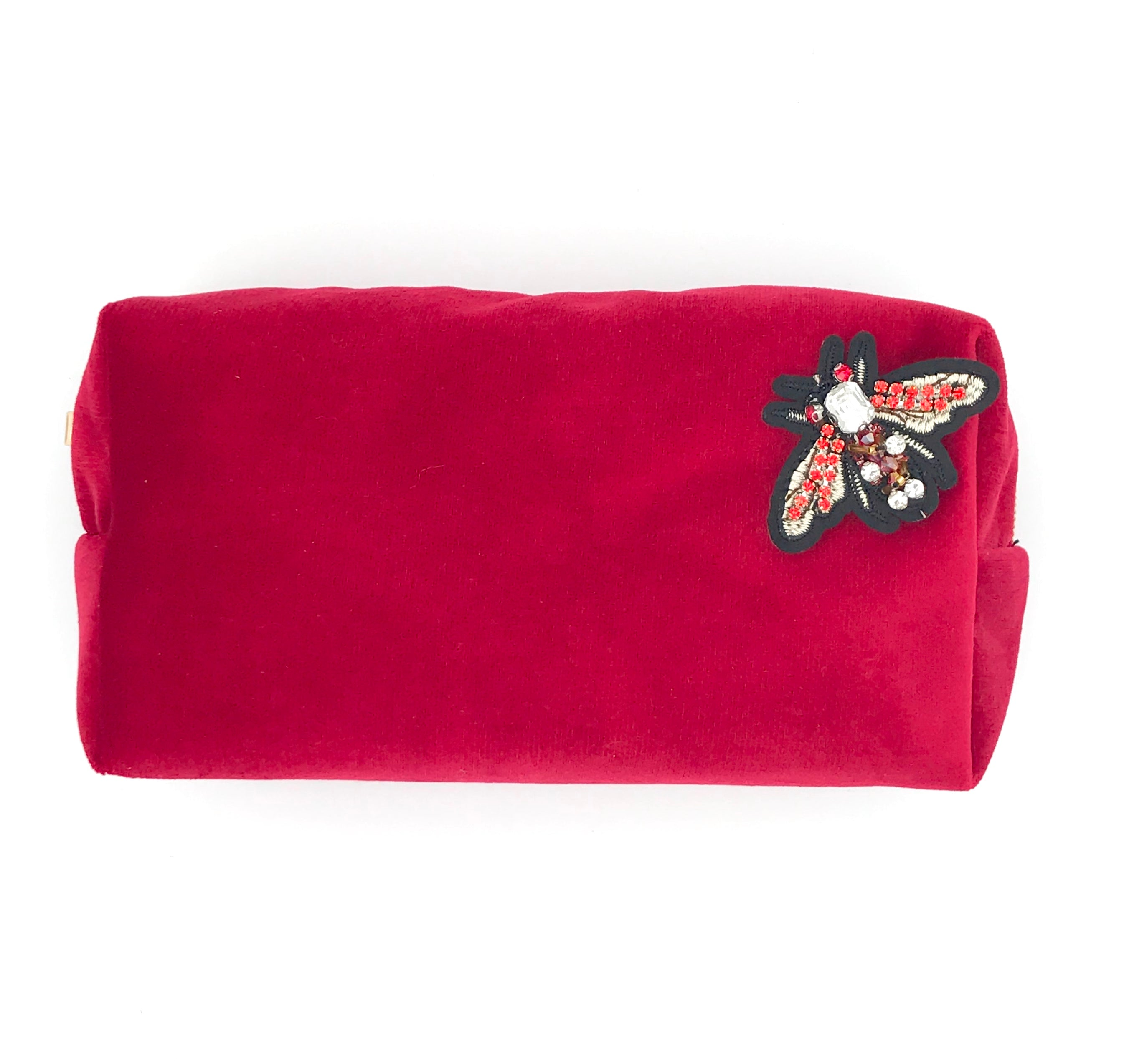Velvet make-up bag in berry with a red jewel pin