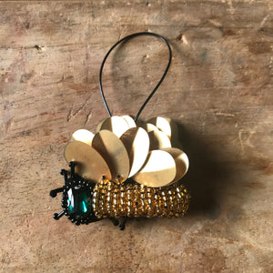 Gold winged insect holiday decoration