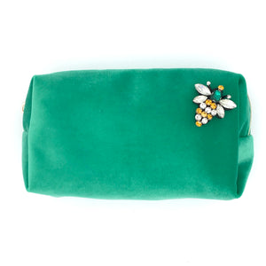 Velvet make-up bag in marine green with a queen bee pin