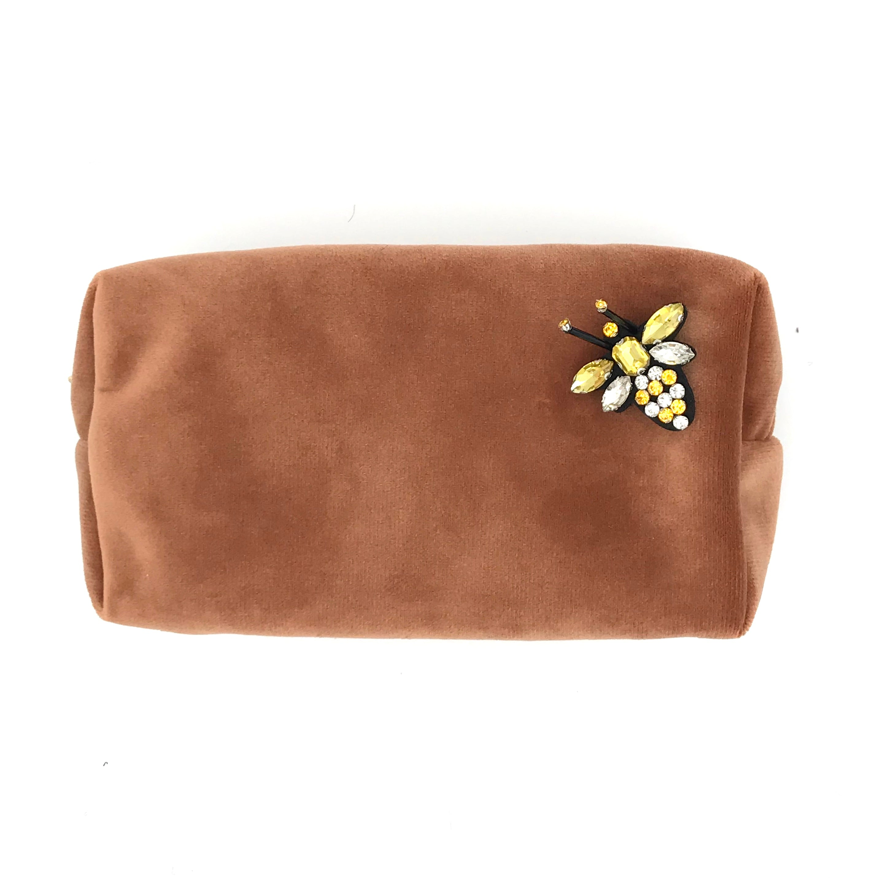 Velvet make-up bag in peach with a bumblebee pin