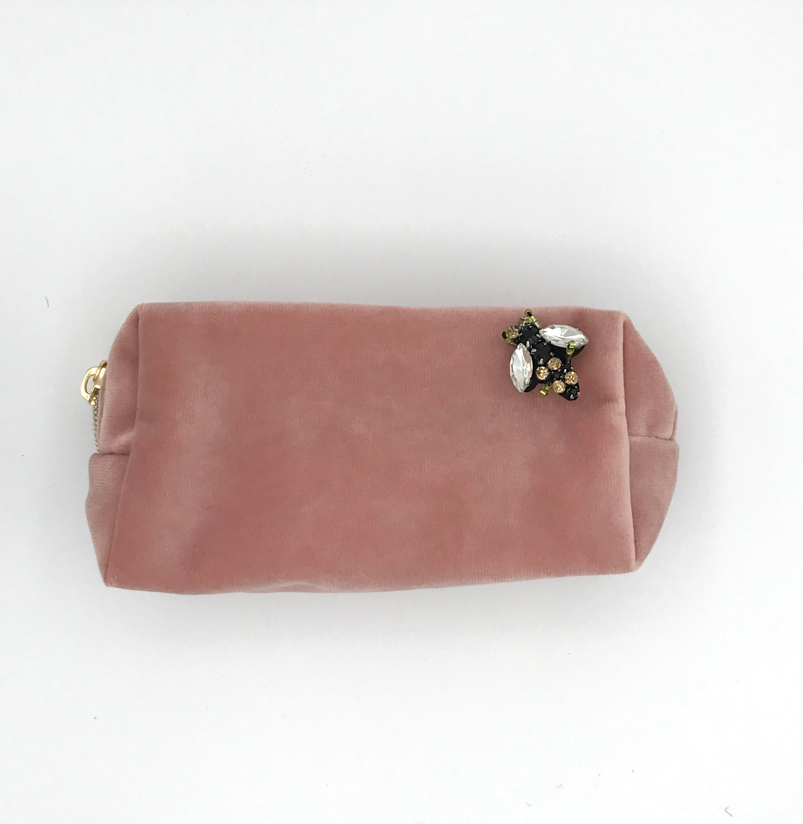 Velvet make-up bag in powder pink with a bumblebee pin