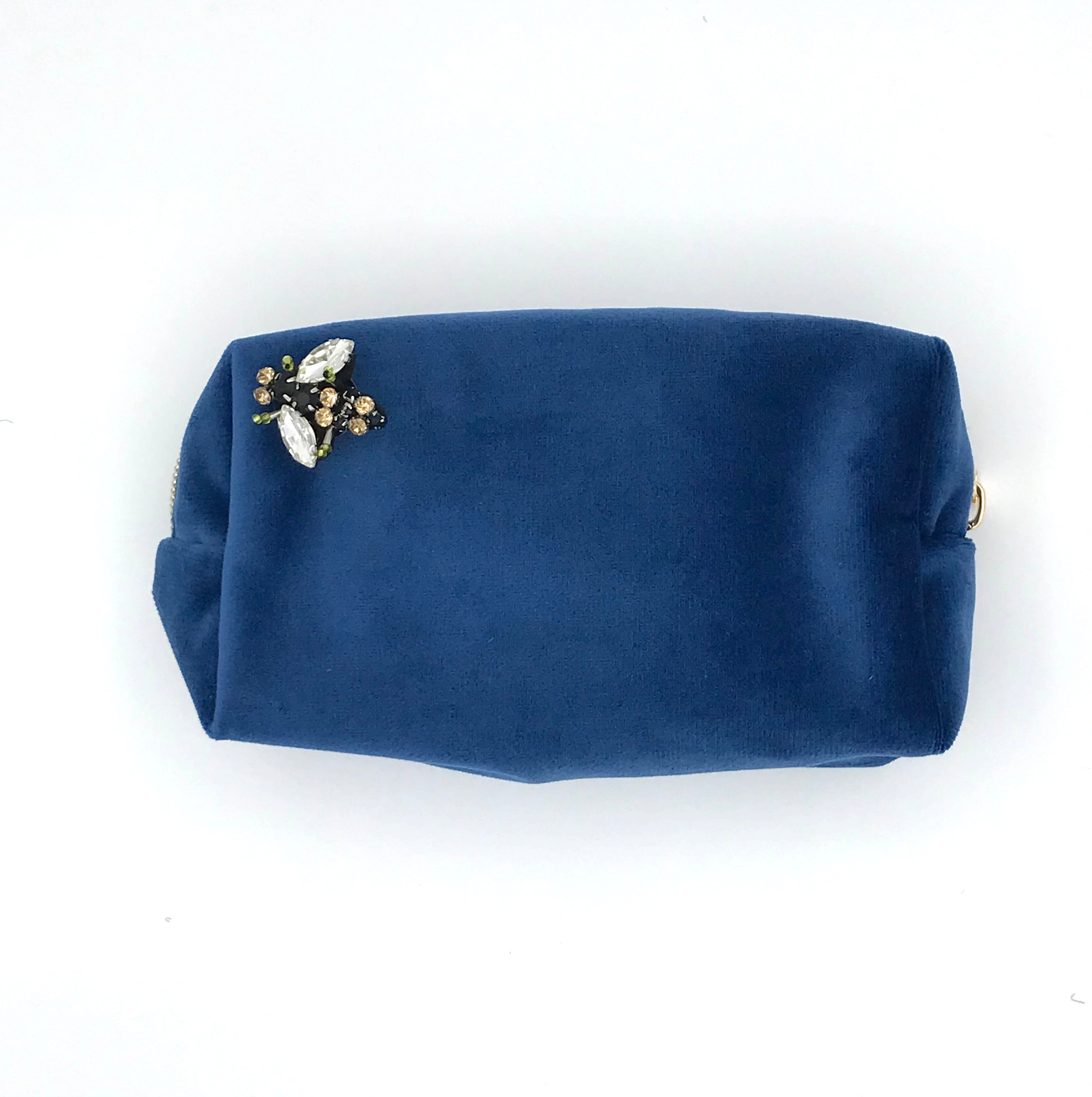 Velvet make-up bag in royal blue with a bumblebee pin