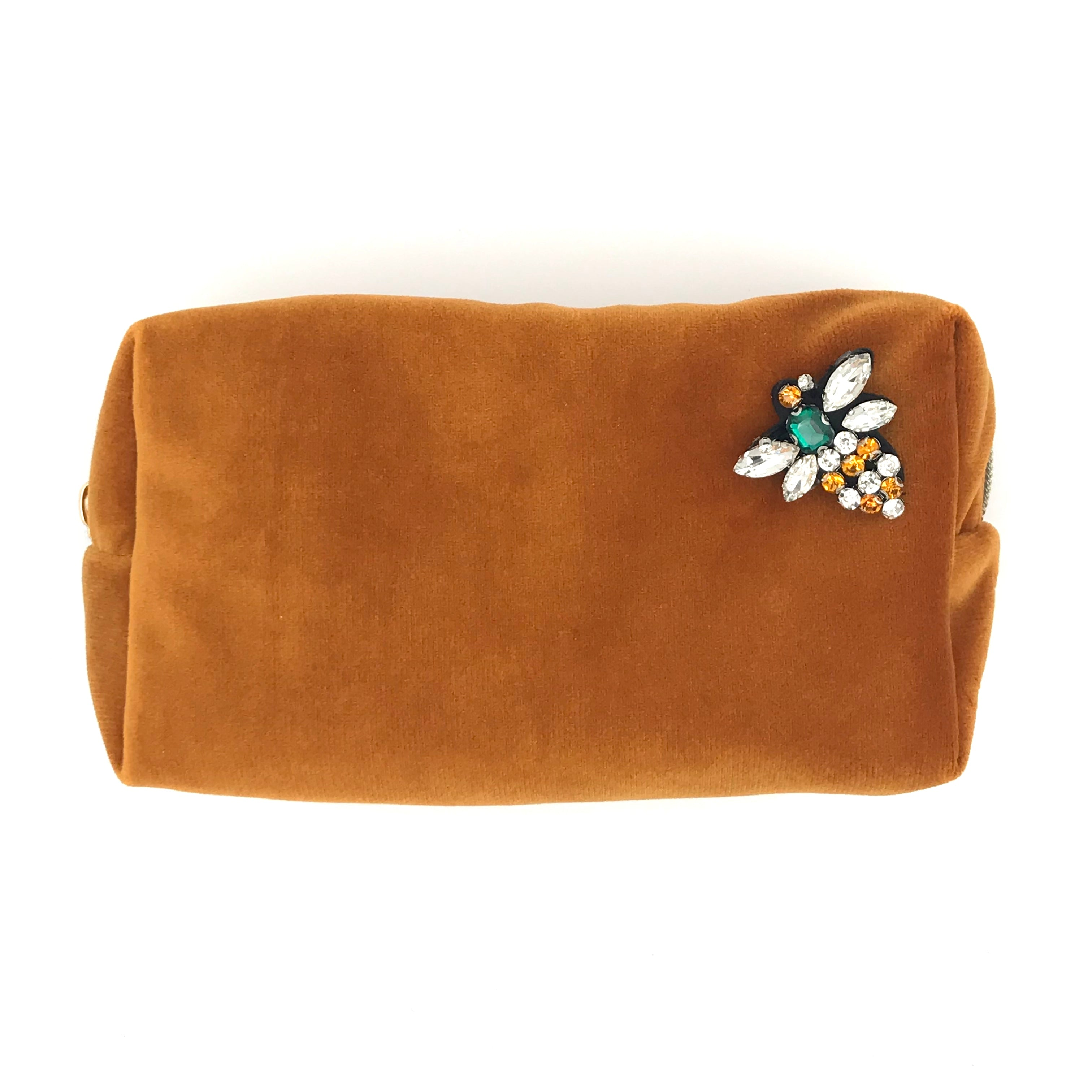Velvet make-up bag in rust with a sparkly bee pin