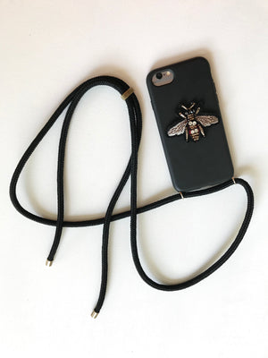 Phone holder with a small insect