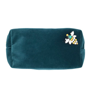 Velvet make-up bag in teal with a queen bee pin