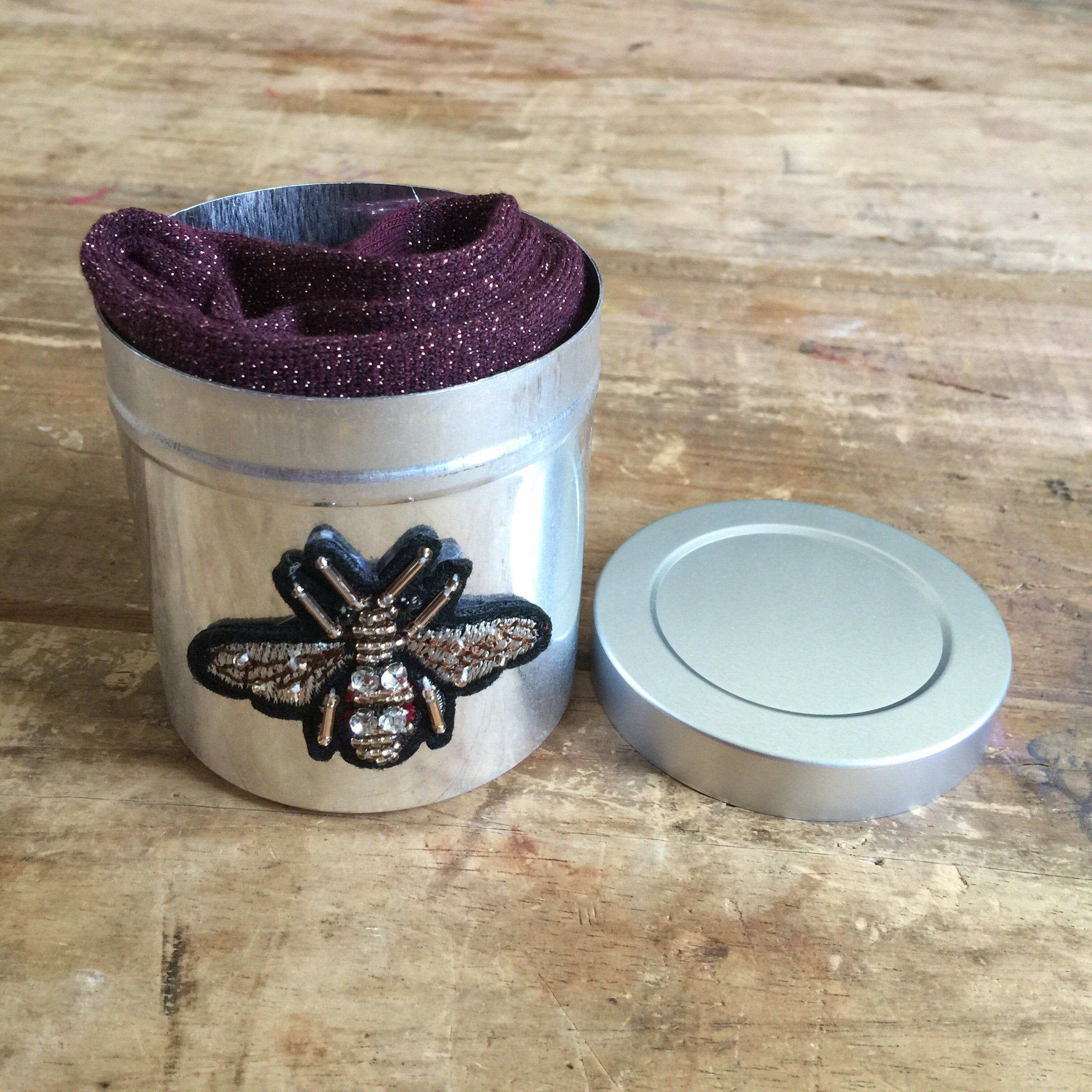 Tokyo plum socks in a small insect tin