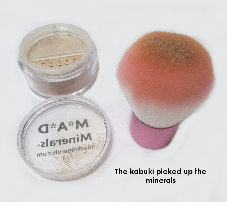 YOU WILL SEE THE MINERALS ON TOP OF THE KABUKI BRUSH