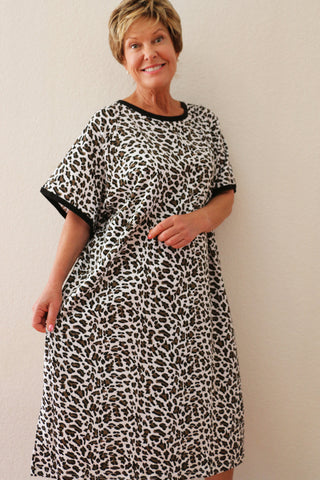 Woman wearing cheetah print hospital gown with short sleeves