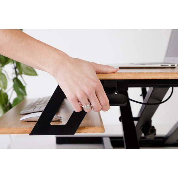 Gas spring system to move standing desk converter up and down easily