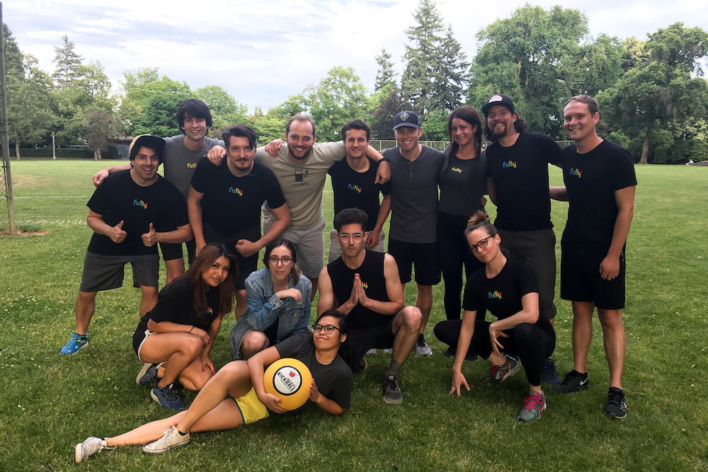 Part of Fully Global playing Kickball together