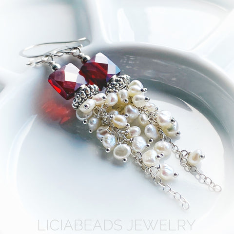 Snowberry, red cubic zirconia and freshwater pearls waterfall cluster earrings