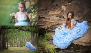 <alt>gorgeous little girls modeling pretty flower girl dresses by miele moda swinging from a tree and holding flowers</alt>
