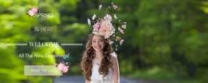 <alt>beautiful girl wearing a fascinator hat with pretty flowers smiling in the park</alt>