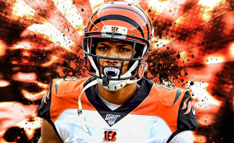 Tyler Boyds mouthguard Tyler Boyds gold mouthguard Bengals mouthguard Tyler Boyd Fang mouth guard