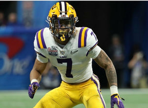 LSU football players wearing crazy mouth guards. LSU Players mouthguard.