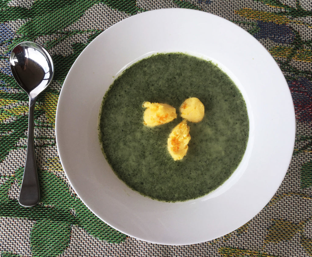 Spinach soup with egg butterballs