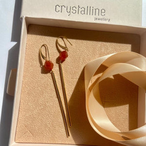 Earrings with red agate