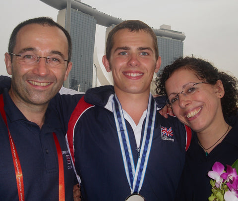 Jonny and his dad celebrating double silvers at the World Marathon Championships