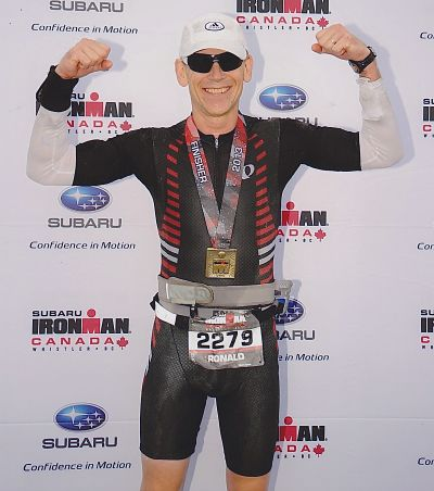 Ron Gordon at end of IRONMAN race