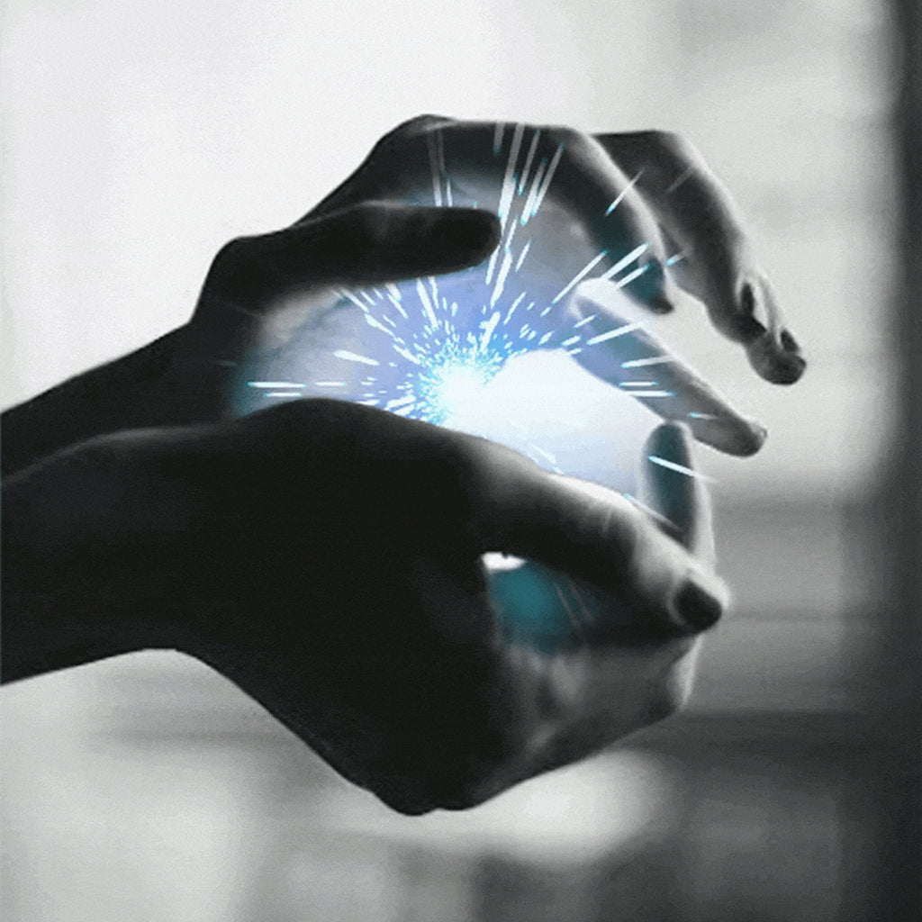 our vision - hands holding a ball of electricity