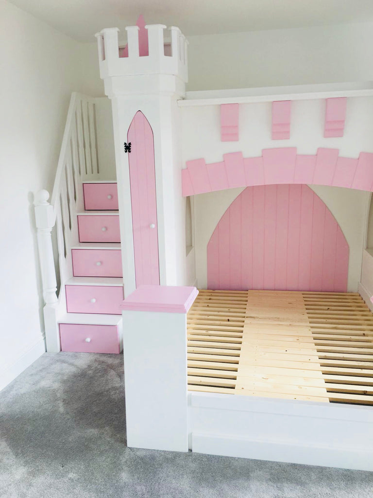 castle bed with drawer stairs and a slide