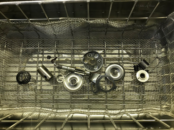 Loose Featherweight Parts being washed