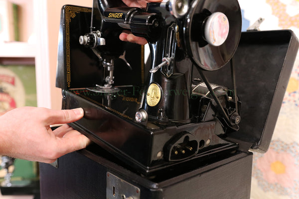 Inserting the Singer Featherweight in its Case