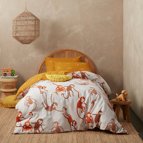 KAS Australia Monkey Kids Quilt Cover Set styled with plush pillows.