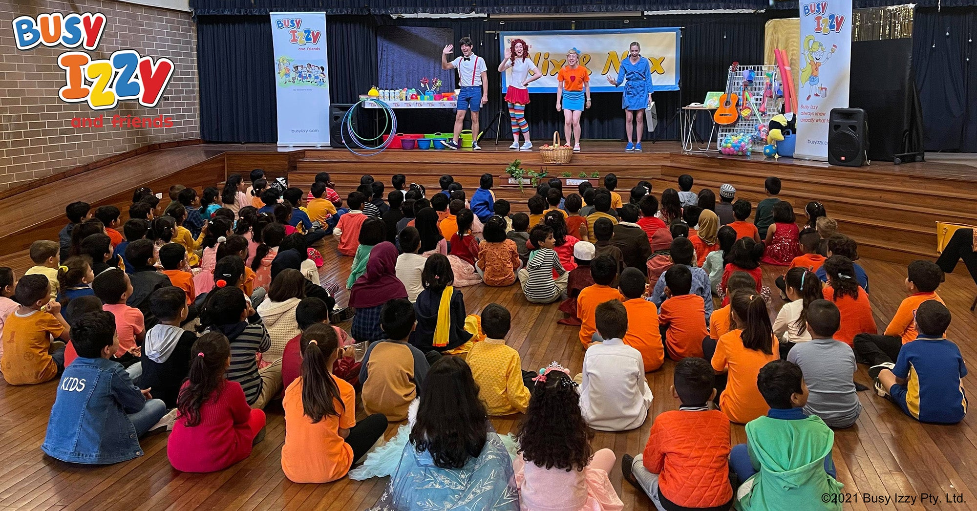 The Busy Izzy Show performers edutaining kids at a Sydney school.