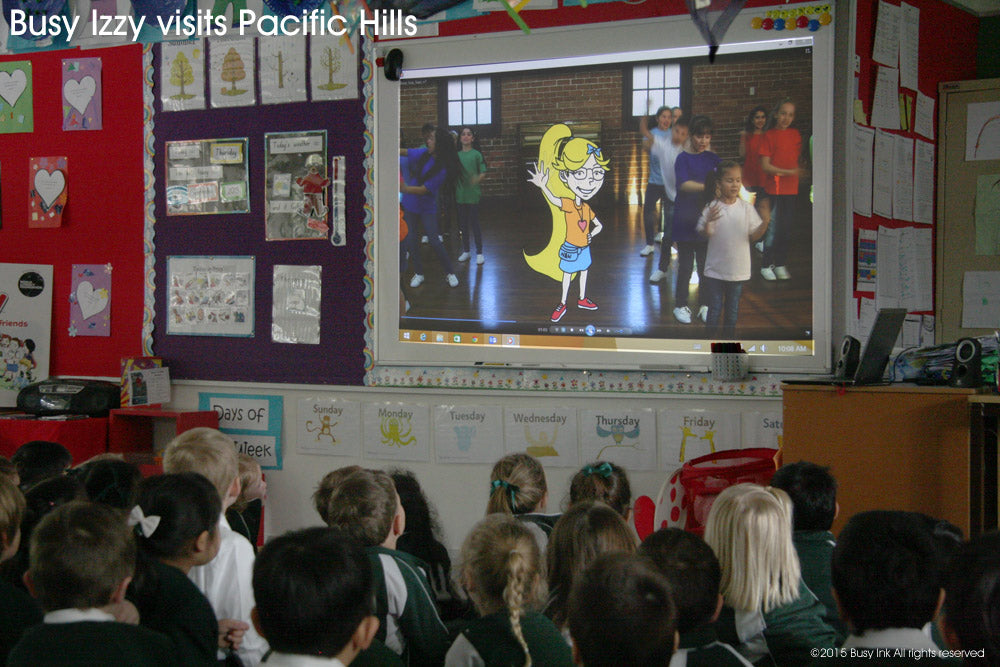 Busy Izzy, Roxanne Kiely and Stephen Kiely visit Pacific Hills Primary School