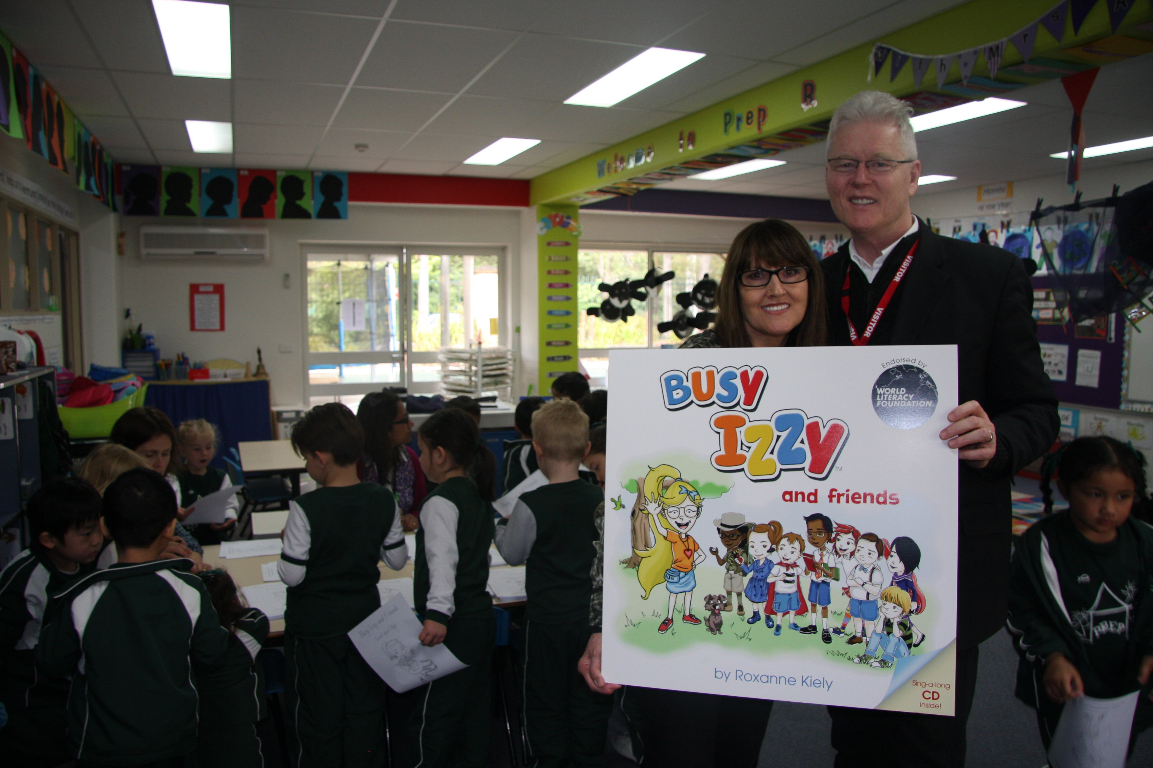 Roxanne Kiely and Stephen Kiely present Busy Izzy and Friends to the students of Pacific Hills Primary school.