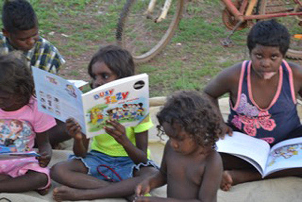Indigenous Australian children reading Busy Izzy and Friends books.