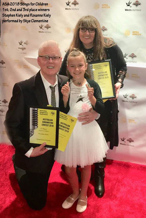 Stephen Kiely and Roxanne Kiely celebrate their 1st Place win in the Song for childrern category of the Australian Songwriters Association 2018 song competition awards. They are pictured here with Skye Clementine, who recorded the song and sang it live at the awards show.